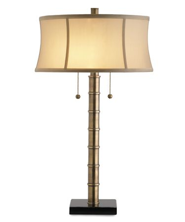 Shown in Antique Brass-Black finish and Champagne Silk shade